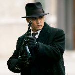 "Johnny Depp just looks so cool holding a submachine gun in ""Public Enemies"" that you almost forgot that John Dillenger was a sociopathic murderer. Too bad the screenwriters did."
